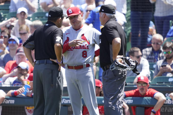 St. Louis Cardinals manager Mike Shildt (8) discusses a call with the umpires during the first inning of a baseball game against the Chicago Cubs, Friday, July 9, 2021, in Chicago. (AP Photo/David Banks)