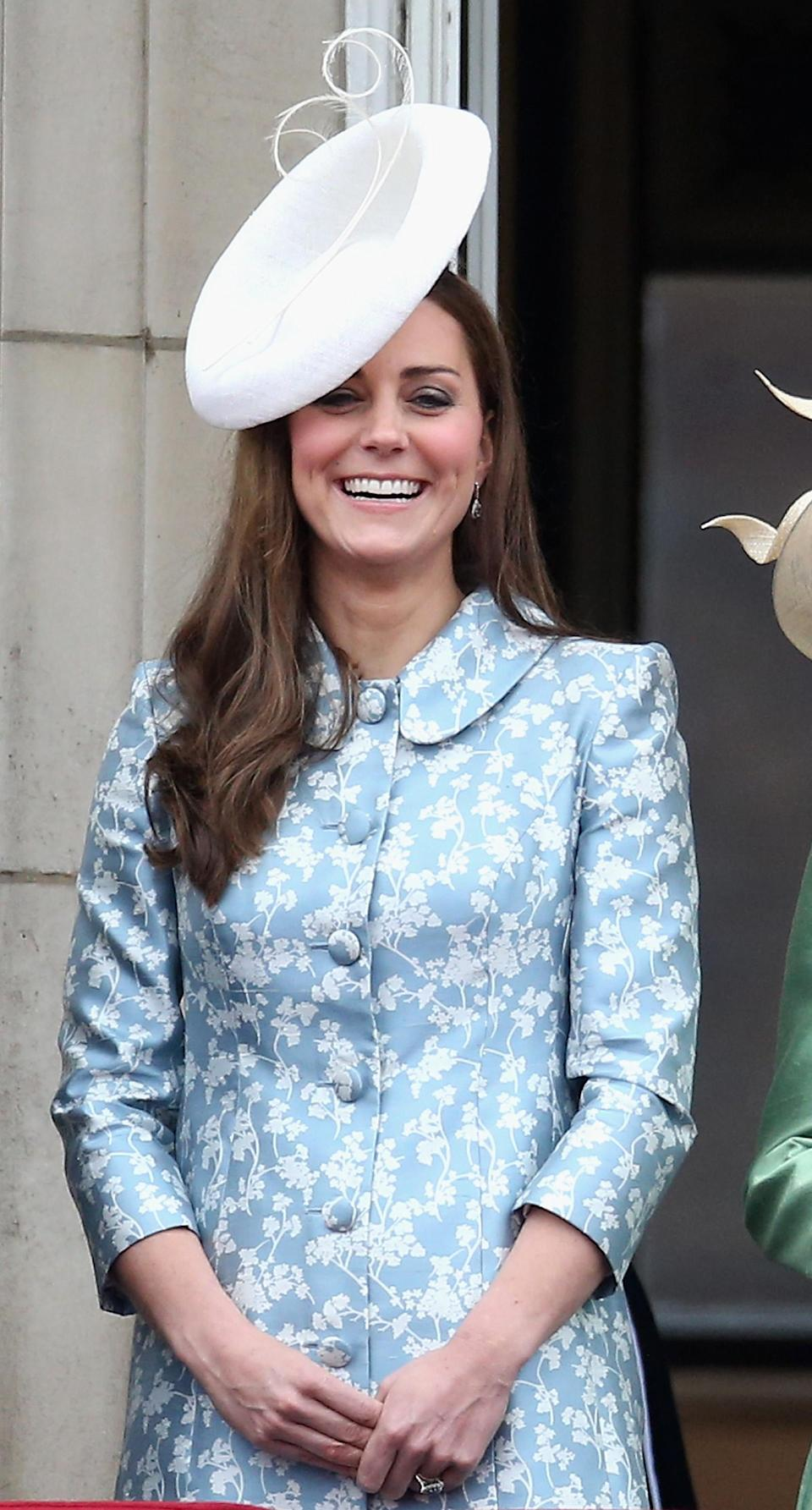 Shortly after Prince George's birth, the Duchess of Cambridge donned a custom-made co-ord by Alexander McQueen. She accessorised the look with a Lock & Co fascinator. (Getty Images)