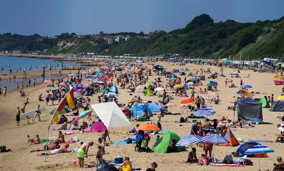 People on Bournemouth beach in Dorset. The season we used to anticipate as the lightest and brightest time of the year now comes with health warnings.