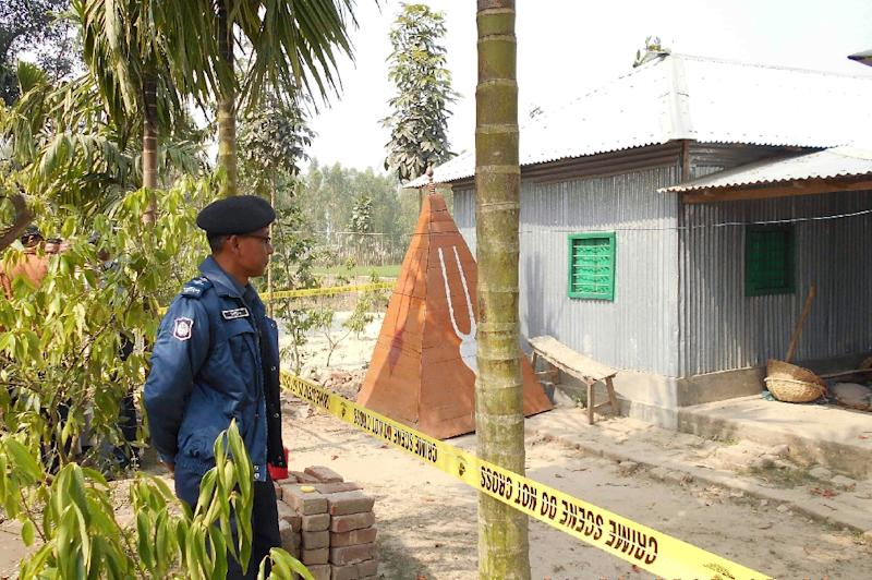A Bangladeshi policeman stands guard where a top Hindu priest was killed in the remote northern district of Panchagarh in February 2016