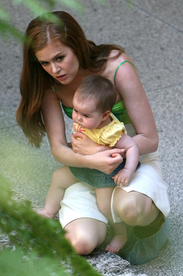 "Isla Fischer takes a break from filming ""Confessions of a Shopaholic"" to tend to daughter Olive. Mike Franklin/<a href=""http://www.filmmagic.com/"" target=""new"">FilmMagic.com</a> - May 4, 2008"
