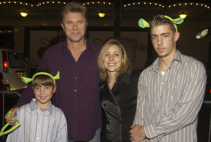 "SYDNEY, AUSTRALIA - JUNE 9: Television personality Richard Wilkins and his children Nick, Miranda and Christian Wilkins (L-R) attend the ""Shrek2"" Premiere at the State Theatre June 9, 2004 in Sydney, Australia. (Photo by Patrick Riviere/Getty Images)"