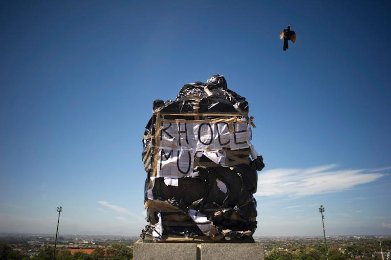 A statue of British coloniser Cecil John Rhodes is covered in plastic bags as part of a protest by students and staff of the University of Cape Town (UCT) on March 20, 2015 (AFP Photo/Rodger Bosch)
