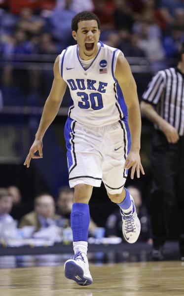Duke guard Seth Curry (30) reacts during the first half of a regional semifinal against Michigan State in the NCAA college basketball tournament, Friday, March 29, 2013, in Indianapolis. (AP Photo/Michael Conroy)