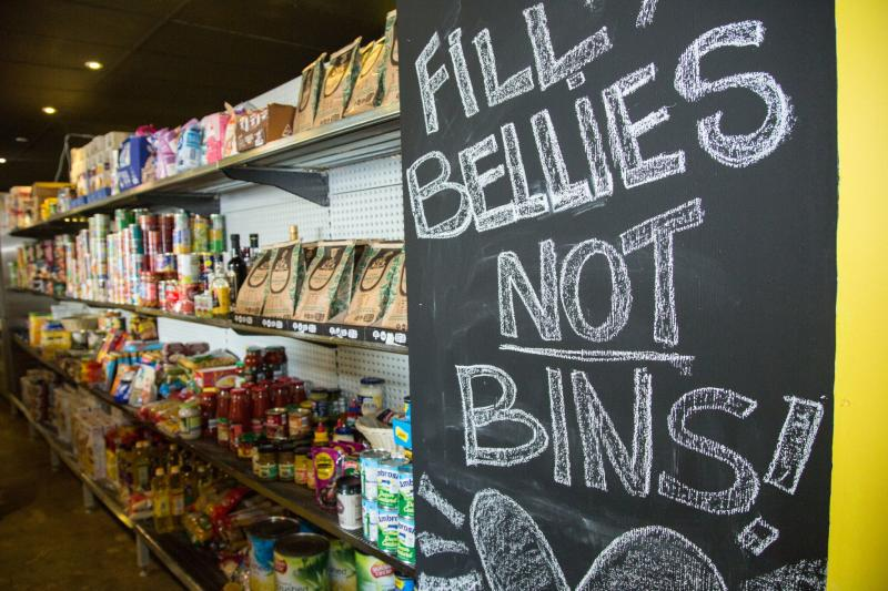 'Full bellies not bins' sign at OzHarvest. Source: Supplied/Livia Giacomini