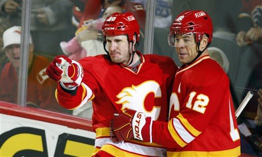 Calgary Flames' Curtis Glencross, left, celebrates his goal with Jarome Iginla against the Winnipeg Jets during the third period of an NHL hockey game in Calgary, Alberta, Friday, March 9, 2012. The Flames won 5-3. (AP Photo/The Canadian Press, Jeff McIntosh)