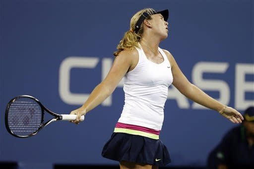 Coco Vandeweghe reacts after missing a shot against Serena Williams at the U.S. Open tennis tournament, Tuesday, Aug. 28, 2012, in New York. (AP Photo/Darron Cummings)