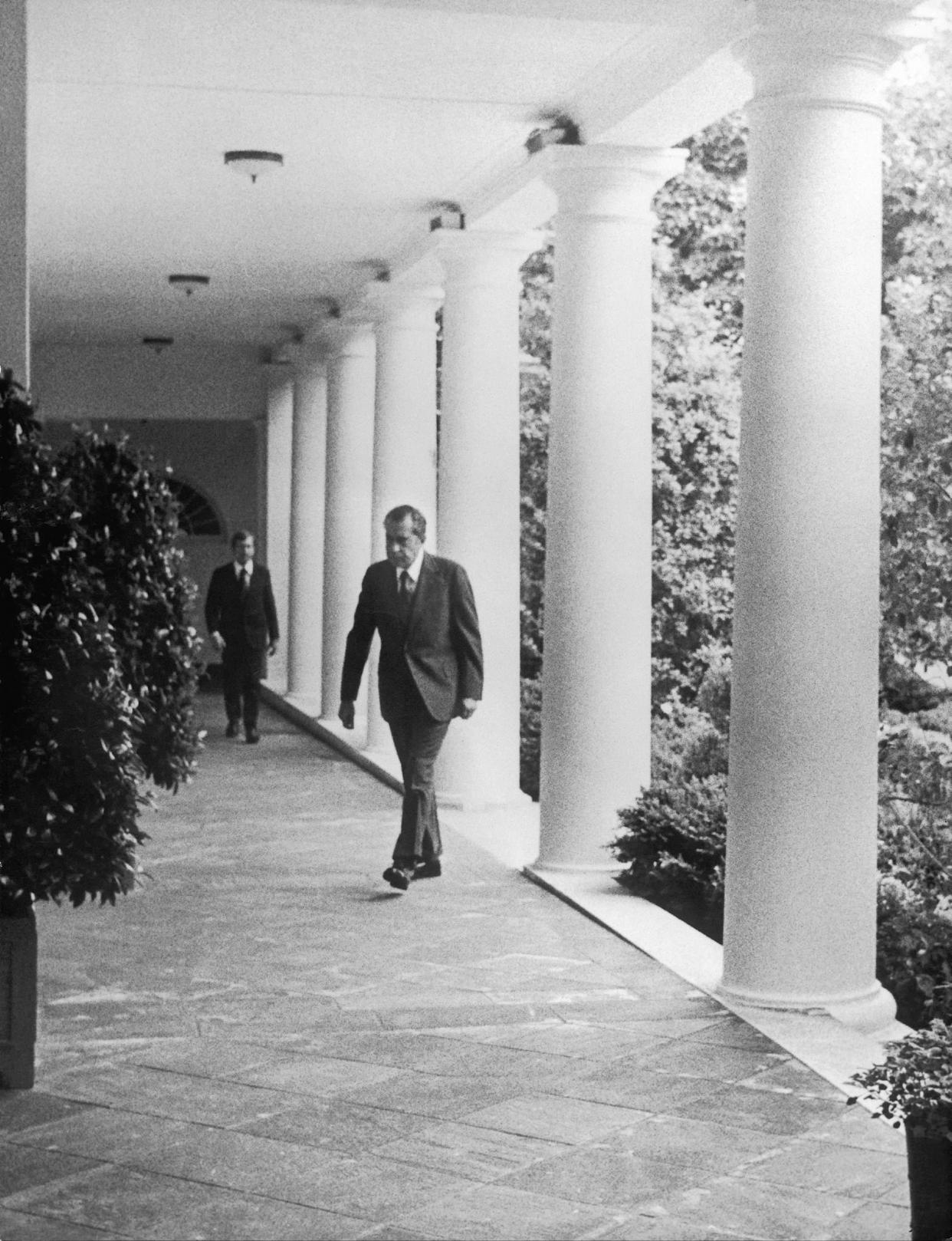 UNITED STATES - MARCH 09: President Richard Nixon Walking Through The Rose Garden At The White House In Washington On August 8, 1974, Before The Televised Announcement Of His Resignation, After Having Been Charged Because Of The Watergate Scandal. (Photo by Keystone-France/Gamma-Keystone via Getty Images)