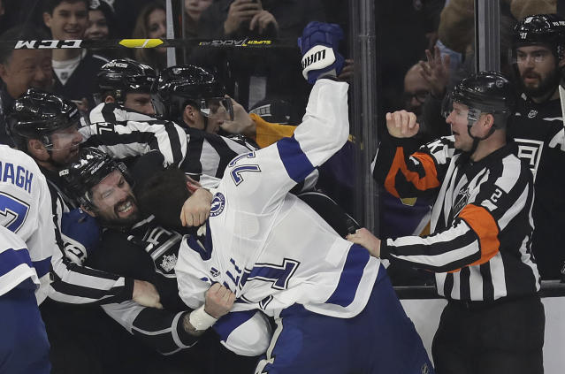 Los Angeles Kings' Nate Thompson (44) fights with Tampa Bay Lightning's Anthony Cirelli (71) during the second period of an NHL hockey game Thursday, Jan. 3, 2019, in Los Angeles. (AP Photo/Marcio Jose Sanchez)