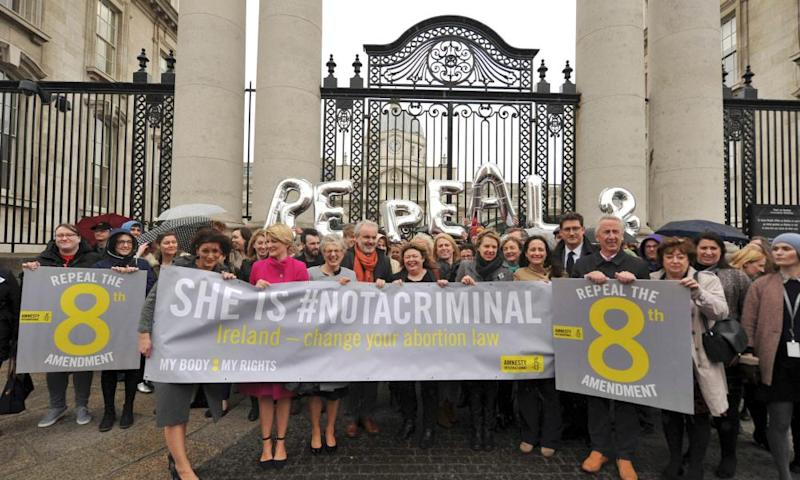 Campaigners against the eighth amendment rally outside government buildings in Dublin last year.