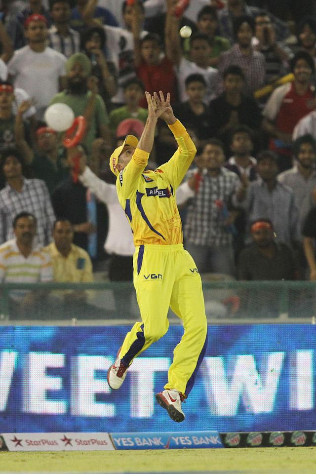 Michael Hussey of Chennai Super Kings leaps p to take the catch to get Manan Vohra of Kings XI Punjab wicket during match 11 of of the Pepsi Indian Premier League between The Kings XI Punjab and the Chennai Superkings held at the PCA Stadium, Mohal, India  on the 10th April 2013..Photo by Shaun Roy-IPL-SPORTZPICS  ..Use of this image is subject to the terms and conditions as outlined by the BCCI. These terms can be found by following this link:..https://ec.yimg.com/ec?url=http%3a%2f%2fwww.sportzpics.co.za%2fimage%2fI0000SoRagM2cIEc&t=1490414229&sig=1h3DtZT01gYyayqPeG9hNA--~C
