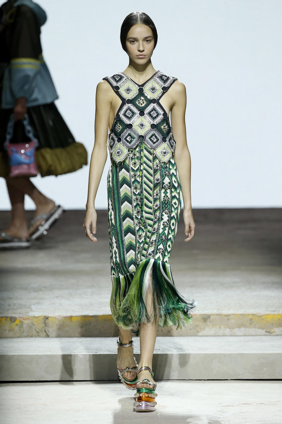 <p><i>Green printed fringe dress from the SS18 Mary Katrantzou collection. (Photo: Getty) </i></p>