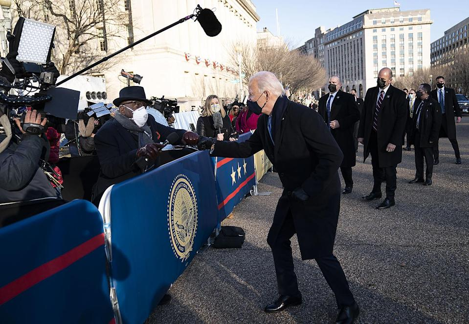 <p>President Biden jogs over to <em>Today</em> anchor Al Roker to give him a friendly fist bump during the parade. </p>