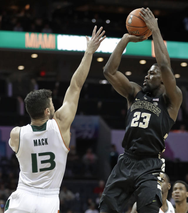 Wake Forest's Chaundee Brown (23) shoots over Miami's Anthony Mack (13) during the first half of an NCAA college basketball game in the Atlantic Coast Conference tournament in Charlotte, N.C., Tuesday, March 12, 2019. (AP Photo/Nell Redmond)
