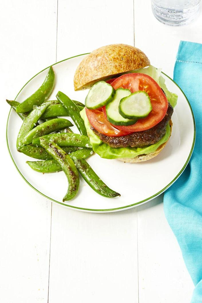 """<p>You can prepare the patties ahead of time and grill them for eight minutes. </p><p><em><a href=""""https://www.womansday.com/food-recipes/food-drinks/a22478344/beef-and-mushroom-burgers-recipe/"""" rel=""""nofollow noopener"""" target=""""_blank"""" data-ylk=""""slk:Get the recipe for Beef and Mushroom Burgers with Snap Pea Fries."""" class=""""link rapid-noclick-resp"""">Get the recipe for Beef and Mushroom Burgers with Snap Pea Fries.</a></em></p>"""