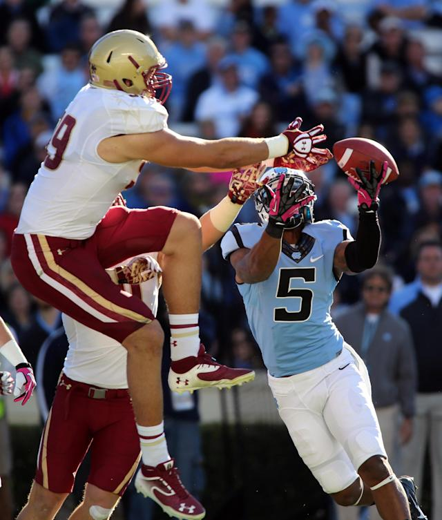 North Carolina wide receiver T.J. Thorpe (5) battles a Boston College defensive player for a tipped ball in the first quarter of an NCAA college football game in Chapel Hill, N.C., Saturday, Oct. 26, 2013 (AP Photo/Nell Redmond)