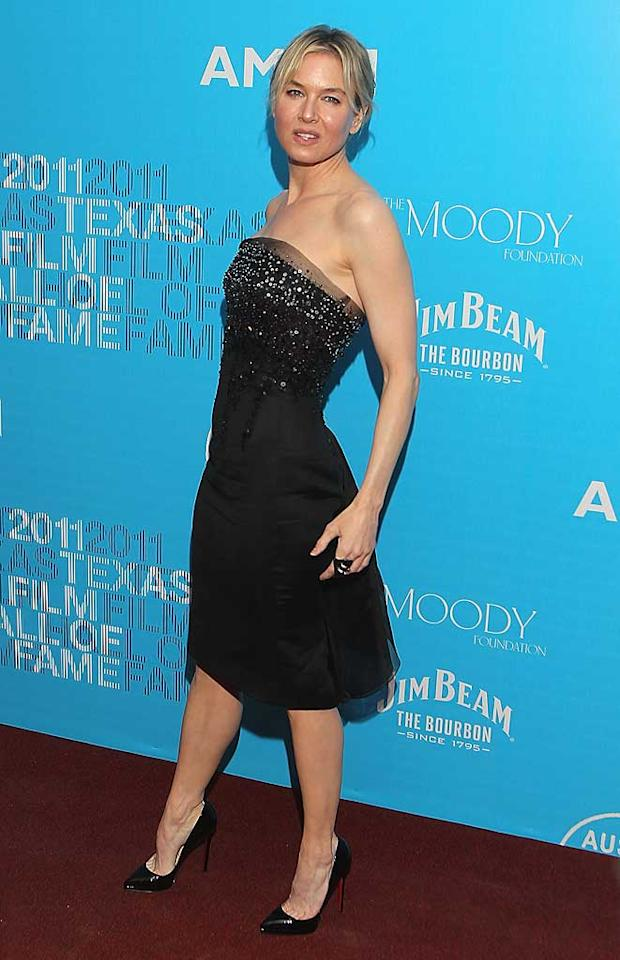 """Also looking amazing this week ... Oscar winner Renee Zellweger, who hit the red carpet at the Texas Film Hall of Fame Awards in a beaded, tulle-accented Carolina Herrera dress, a monstrous cocktail ring, and fierce Louboutin heels. Gary Miller/<a href=""""http://www.filmmagic.com/"""" target=""""new"""">FilmMagic.com</a> - March 10, 2011"""
