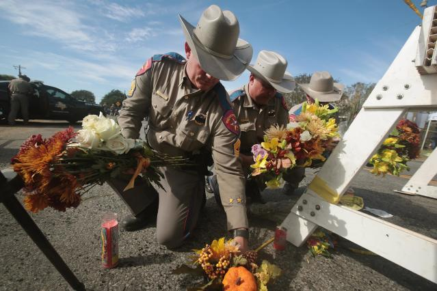 <p>Police move flowers placed at a barricade near the First Baptist Church of Sutherland Springs on Nov. 6, 2017 in Sutherland Springs, Texas. (Photo: Scott Olson/Getty Images) </p>