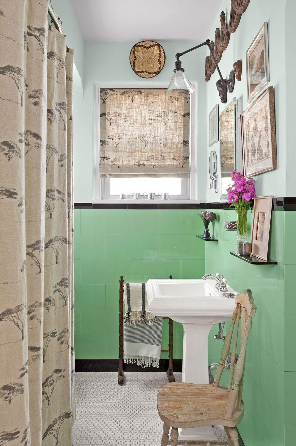 <p>In this bathroom, mint green tiles add a playful element while neutral tones add a sense of warmth. </p>