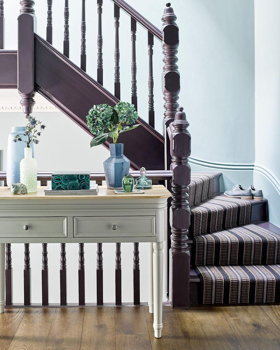 """<p>Bring a touch of plush texture to your home with traditional hues, such a dark purple or classic brown. To truly set the mood, why not paint your staircase bannister the same colour as your carpet? Bold and daring, yes, but it will wow guests in an instant. </p><p>Pictured: <a href=""""https://go.redirectingat.com?id=127X1599956&url=https%3A%2F%2Fwww.oakfurnitureland.co.uk%2Ffurniture%2Fbrindle-natural-oak-and-painted-console-table%2F1010100.html&sref=https%3A%2F%2Fwww.housebeautiful.com%2Fuk%2Fdecorate%2Ffloors%2Fg36263776%2Fstair-carpet%2F"""" rel=""""nofollow noopener"""" target=""""_blank"""" data-ylk=""""slk:Console table, £269.99, Oak Furnitureland"""" class=""""link rapid-noclick-resp"""">Console table, £269.99, Oak Furnitureland</a></p>"""