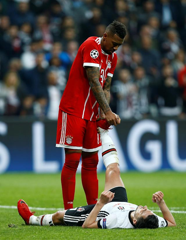 Soccer Football - Champions League Round of 16 Second Leg - Besiktas vs Bayern Munich - Vodafone Arena, Istanbul, Turkey - March 14, 2018 Bayern Munich's Jerome Boateng helps Besiktas' Mustafa Pektemek with cramp REUTERS/Osman Orsal