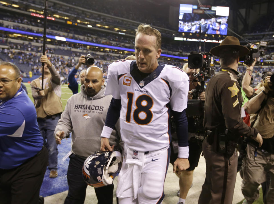 """FILE - Denver Broncos quarterback Peyton Manning (18) walks off the field after an NFL football game against the Indianapolis Colts in Indianapolis, in this Sunday, Oct. 20, 2013, in Indianapolis. The Colts won 39-33. After five straight victories to open the season with his new team, the Broncos, Manning was on his way to his record fifth MVP award while setting all sorts of league passing marks. The matchup with the Colts in Indianapolis was ballyhooed like the second coming, but despite Manning's brilliance _ three touchdown passes, 386 yards in the air _ his replacement, Andrew Luck, got the win 39-33. """"I am kind of relieved in some ways that this game is over,"""" he said at the end of a long night. (AP Photo/Michael Conroy, File)"""