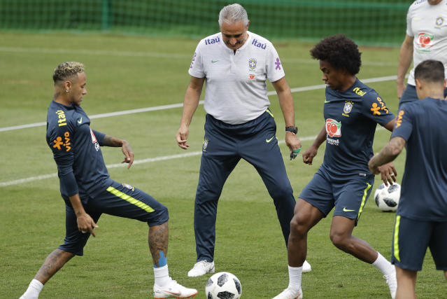 Brazil head coach Tite, center, Neymar, left, and Willian practice during a training session in Sochi, Russia, Tuesday, June 19, 2018. Brazil will face Costa Rica on June 22 in the group E for the soccer World Cup. (AP Photo/Andre Penner)