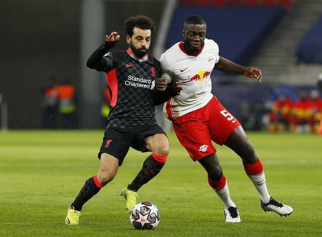 Liverpool's Mohamed Salah and RB Leipzig's Dayot Upamecano battle for the ball