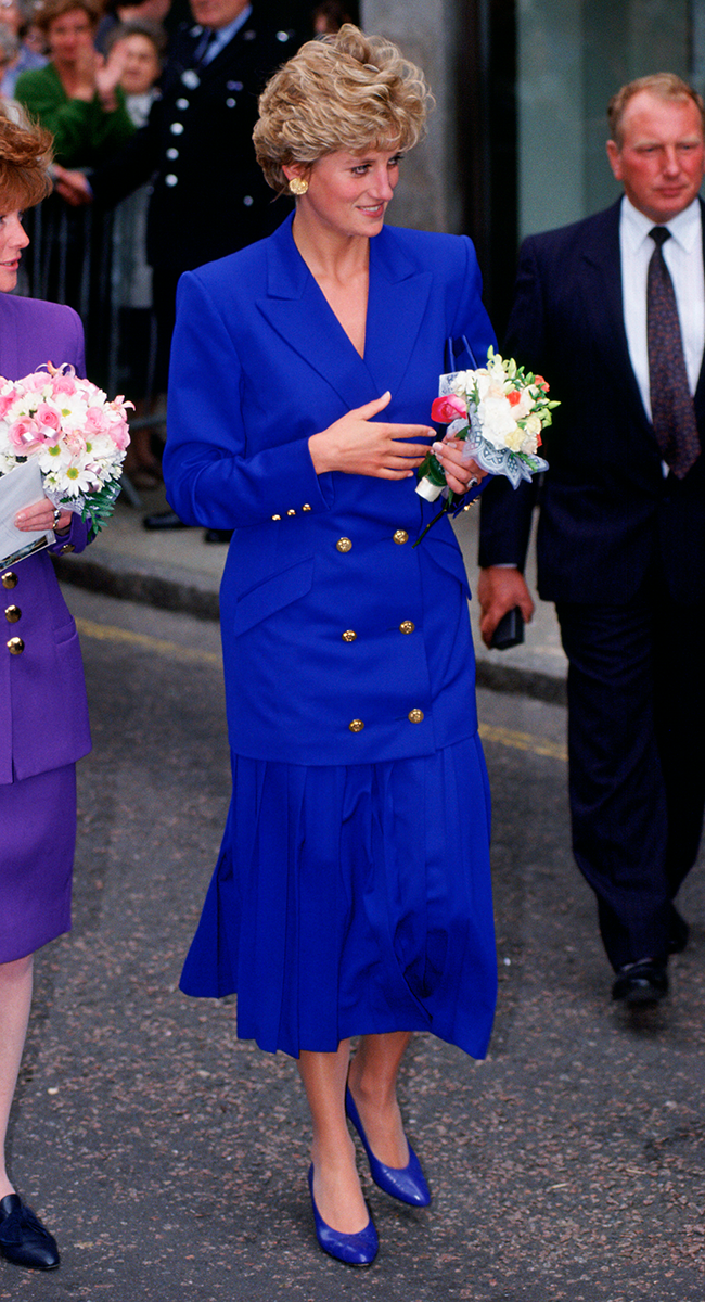 <p>Remember what we said about Diana's love of the skirt suit? Well, this electric blue ensemble, complete with shoulder pads, gold buttons, pleated skirt and matching pumps is a case in point.</p>