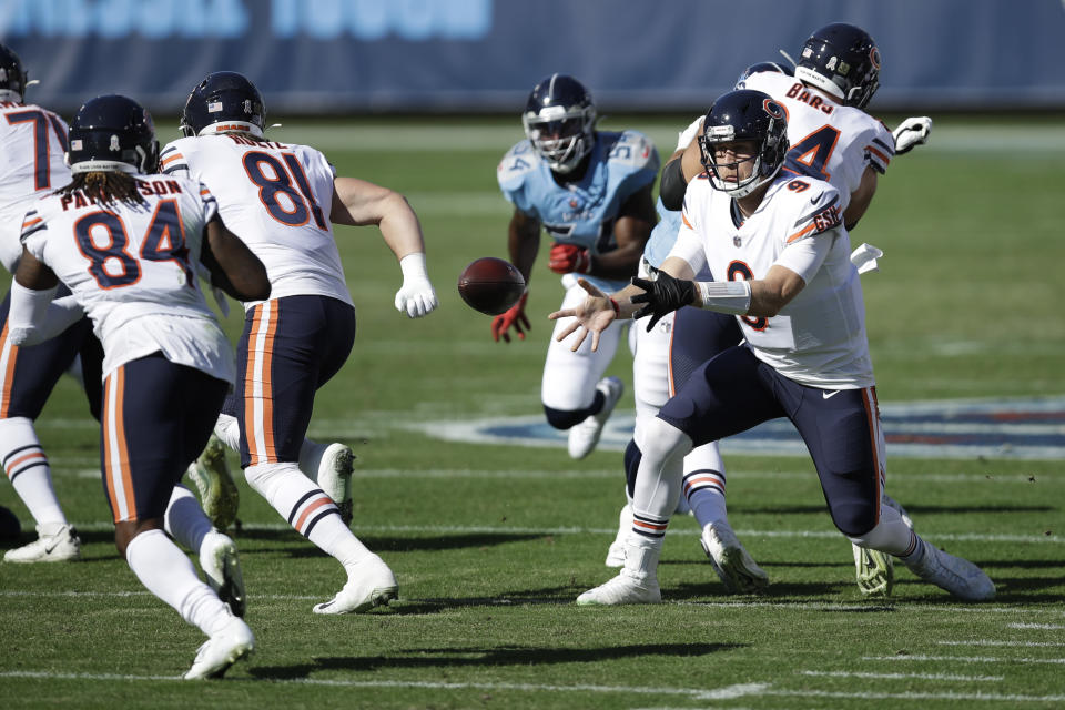 Chicago Bears quarterback Nick Foles (9) pitches the ball out to wide receiver Cordarrelle Patterson (84) in the first half of an NFL football game against the Tennessee Titans Sunday, Nov. 8, 2020, in Nashville, Tenn. (AP Photo/Ben Margot)