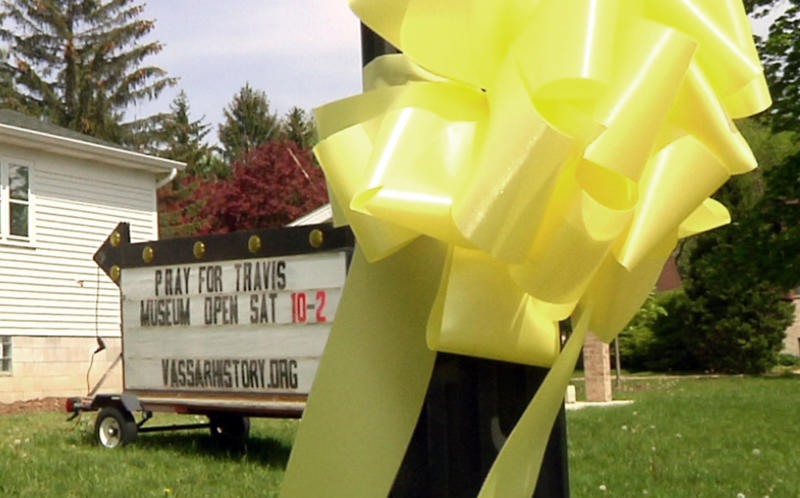 In a photo made May 8, 2012, a yellow ribbon is seen in Vassar, Mich., in support of Travis Mills. Family and community are rallying around the 'Superman' soldier from Mich. who lost all 4 limbs in IED blast. (AP Photo/Mike Householder)
