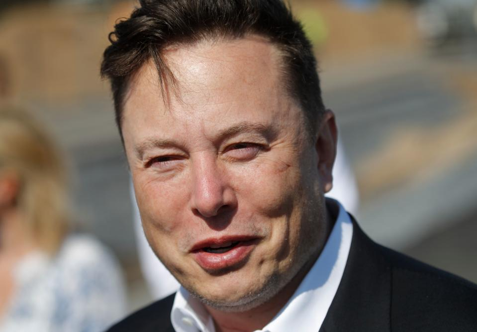 Tesla CEO Elon Musk talks to media as he arrives to visit the construction site of the future US electric car giant Tesla, on September 03, 2020 in Gruenheide near Berlin. - Tesla builds a compound at the site in Gruenheide in Brandenburg for its first European
