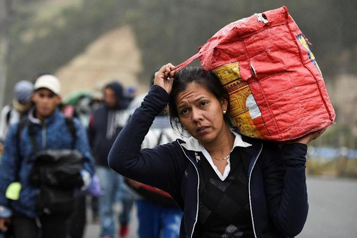 Venezuelan migrants are bearing precarious conditions often on foot to flee their country and head for safer pastures to the south (AFP Photo/Luis ROBAYO)