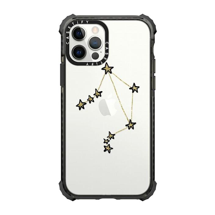 """<p><strong>CASETiFY</strong></p><p>casetify.com</p><p><strong>$59.00</strong></p><p><a href=""""https://go.redirectingat.com?id=74968X1596630&url=https%3A%2F%2Fwww.casetify.com%2Fproduct%2Flibra-x-astrology-x-zodiac%2Fiphone12-pro%2Fultra-impact-case%23%2F16001659&sref=https%3A%2F%2Fwww.cosmopolitan.com%2Fstyle-beauty%2Ffashion%2Fg37091873%2Fgifts-for-astrology-lovers%2F"""" rel=""""nofollow noopener"""" target=""""_blank"""" data-ylk=""""slk:Shop Now"""" class=""""link rapid-noclick-resp"""">Shop Now</a></p><p>A gift that's cute <em>and</em> protective? Down.</p>"""