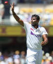 India's Thangarasu Natarajan reaches to catch the ball during play on the first day of the fourth cricket test between India and Australia at the Gabba, Brisbane, Australia, Friday, Jan. 15, 2021. (AP Photo/Tertius Pickard)