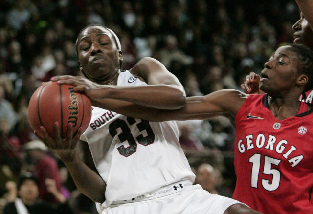South Carolina's Elem Ibiam (33) tries to keep a rebound from Georgia's Krista Conald (15) during the first half of an NCAA college basketball game Thursday, Feb. 27, 2014, in Columbia, S.C. (AP Photo/Mary Ann Chastain)