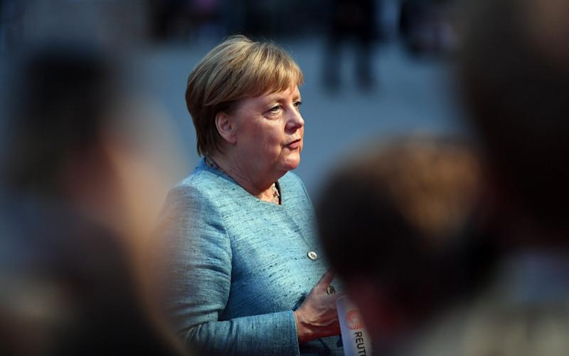 Mrs Merkel admitted there was 'nothing to gloss over' as she received another body blow after a bruising summer of coalition run-ins - AFP