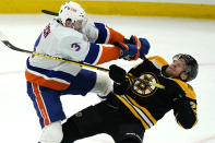 New York Islanders defenseman Adam Pelech (3) checks Boston Bruins right wing Ondrej Kase (28) to the ice in the second period of an NHL hockey game, Monday, May 10, 2021, in Boston. (AP Photo/Elise Amendola)