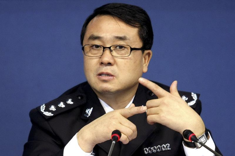 FILE - In this Oct. 21, 2008 file photo, then Chonqing city police chief Wang Lijun speaks during a press conference in Chongqing, southwestern China. Wang, the ex-police chief at the center of China's seamy political scandal asked U.S. diplomats for asylum after he covered up a murder for the wife of the Communist Party boss but then grew estranged and feared for his life, the Chinese government said Wednesday, Sept. 19, 2012.  (AP Photo, File) CHINA OUT