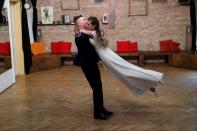 Tokacs-Mathe and Aszalos practice their wedding dance as the coronavirus disease (COVID-19) restrictions are eased in Budapest