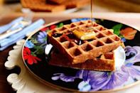 """<p>There's nothing better than a thick, fluffy waffle for breakfast on the weekends—but before you get to mixing your batter, you should probably invest in one of the best waffle makers. The type of waffle you want to make will totally dictate what iron you buy: Some make wide and thin Waffle House-style waffles, while others churn out big, fluffy, Belgian-style ones, like Ree Drummond's <a href=""""https://www.thepioneerwoman.com/food-cooking/recipes/a11684/waffles/"""" rel=""""nofollow noopener"""" target=""""_blank"""" data-ylk=""""slk:favorite classic waffles"""" class=""""link rapid-noclick-resp"""">favorite classic waffles</a>. You can also choose between an electric waffle maker and a stovetop iron that can be used over any stove or even a campfire. If you're looking for something unique, you might be interested in a stuffed waffle maker or one that makes differently shaped waffles. (It never hurts to add a little whimsy to the breakfast table!)<br></p><p>Once you bring your new waffle maker home, you'll realize there's actually a lot you can do with it beyond its obvious intended function. Add potatoes and cheese to the iron to make <a href=""""https://www.thepioneerwoman.com/food-cooking/recipes/a32475948/flank-steak-with-cheesy-waffle-hash-browns-recipe/"""" rel=""""nofollow noopener"""" target=""""_blank"""" data-ylk=""""slk:hash browns"""" class=""""link rapid-noclick-resp"""">hash browns</a>, get creative at dinnertime with <a href=""""https://www.instagram.com/p/4mqSpnRXU-"""" rel=""""nofollow noopener"""" target=""""_blank"""" data-ylk=""""slk:savory waffles"""" class=""""link rapid-noclick-resp"""">savory waffles</a>, and even try <a href=""""https://www.thepioneerwoman.com/just-for-fun/a34017161/pizza-waffle-iron-hack/"""" rel=""""nofollow noopener"""" target=""""_blank"""" data-ylk=""""slk:reheating your pizza"""" class=""""link rapid-noclick-resp"""">reheating your pizza</a> in one! </p><p>Below you'll find a dozen of the best waffle makers for whatever kind of waffle you like. Once you've mastered Ree's basic recipe mentioned above, try your hand at her <a href=""""h"""