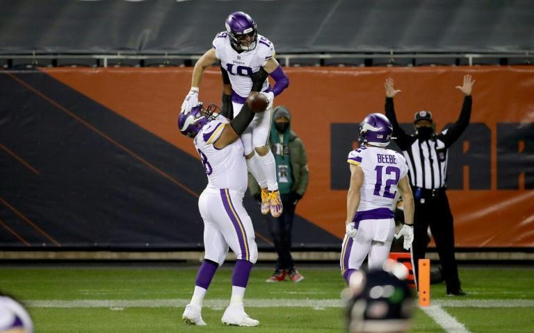 Adam Thielen celebrates one of his two touchdowns during Minnesota's 19-13 victory over the Chicago Bears at Soldier Field