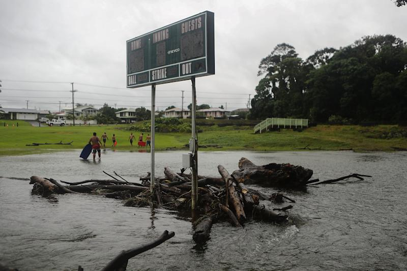 Floodwaters surround a baseball scoreboard during flooding from Tropical Storm Lane on the Big Island, in Hilo, Hawaii.  (Photo: Mario Tama via Getty Images)