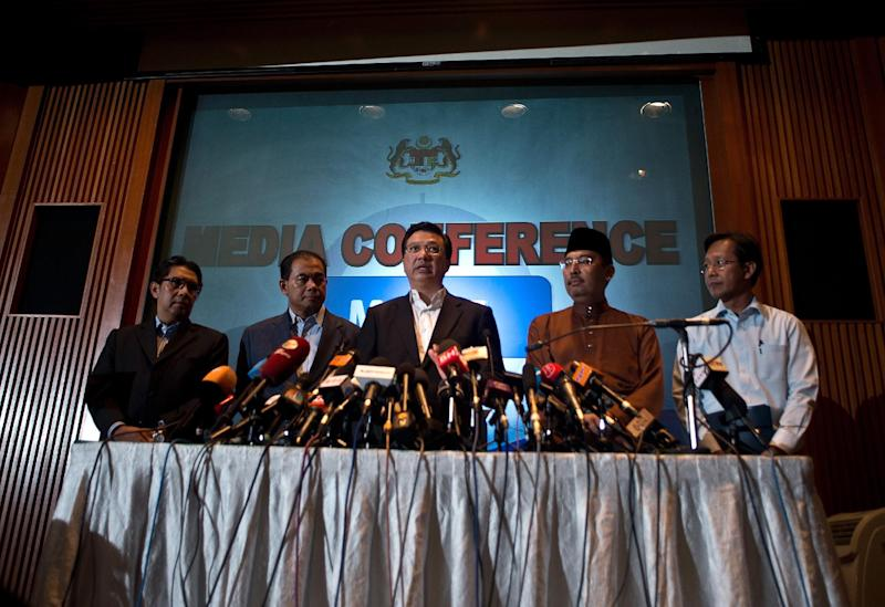 Malaysia's newly appointed Transport Minister Liow Tiong Lai (C) addresses the media