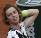 Russia's Andrey Rublev celebrates winning his fourth round match of the French Open tennis tournament against Hungary's Marton Fucsovics at the Roland Garros stadium in Paris, France, Monday, Oct. 5, 2020. (AP Photo/Alessandra Tarantino)