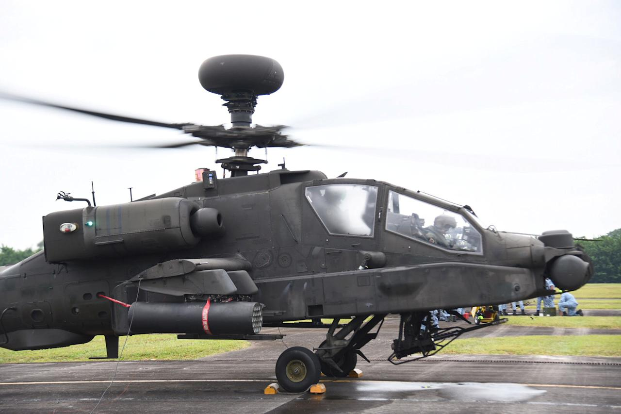 It is armed with a 30 mm (1.18 in) M230 chain gun carried between the main landing gear, under the aircraft's forward fuselage, and four hardpoints mounted on stub-wing pylons for carrying armament and stores, typically a mixture of AGM-114 Hellfire missiles and Hydra 70 rocket pods.