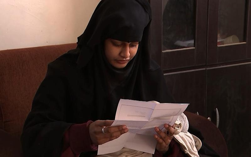 Shamima Begum reading a letter from the Home Office - PA