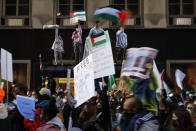 Protesters march through the streets of Chicago's Loop in support of Palestinians, Wednesday, May 12, 2021. (AP Photo/Shafkat Anowar)