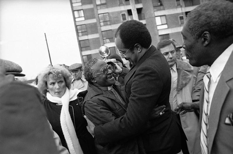 FILE - In this Jan. 14, 1986, file photo, Bishop Desmond Tutu, left, is greeted by Rep. William H. Gray III, who just returned from a trip to South Africa, outside Philadelphia's Bright Hope Baptist Church. Gray, who rose to influential positions in Congress while remaining pastor of his north Philadelphia church for 3½ decades, has died, a family spokesman said Monday, July 1, 2013. He was 71. (AP Photo/Peter Morgan, File)