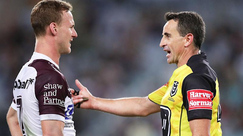 Seen here, Manly captain Daly Cherry-Evans and referee Gerard Sutton.